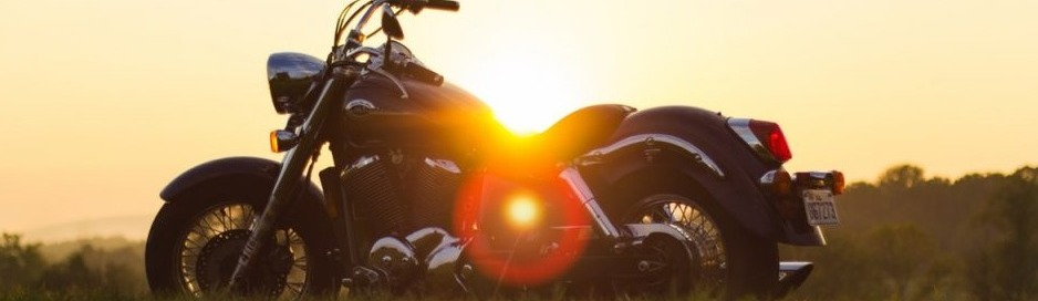 motorcycle overlooking a sunset